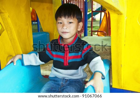 An handsome Asian kid of Thailand  in Playground