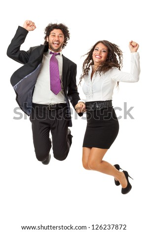 An handsome businessman and a gorgeous businesswoman jumping over a white background