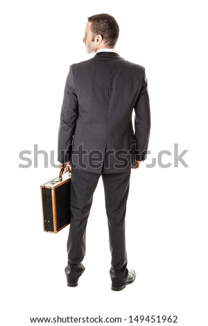 an handsome businessman with a briefcase isolated over a white background