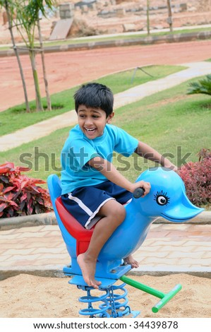 An handsome Indian kid having funat a local park