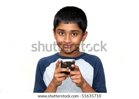 An handsome Indian kid playing games with teh cell phone