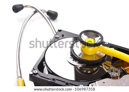 An hard disk with a stethoscope isolated on white background