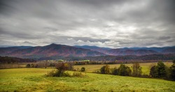 An HDR image of a valley and fall colors and overcast cloudy sky in the mountains of Tennessee.