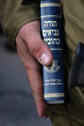 an Hebrew Bible in the IDF ceremony. translation: torah, Prophets, Hagiography = Hebrew Bible