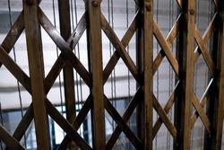 an historicbuilding old elevator safety door metal cage
