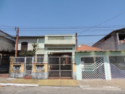 An horizontal picture of a facade of a typical suburban house in São Paulo  Brazil on a sunny day,