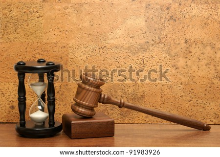 An hourglass and gavel represent a concept based on needing time for legal aid.