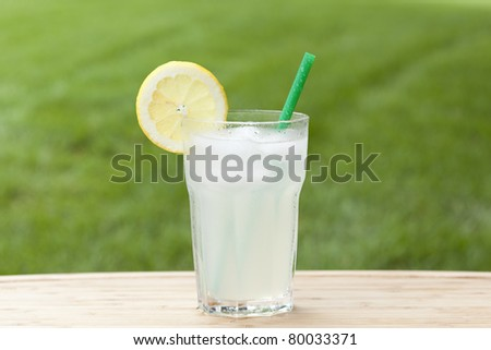 An ice cold lemonade on a wooden board