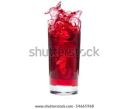An ice cube splashes into cold cranberry juice - stock photo