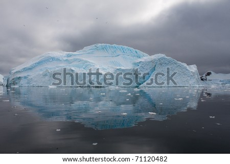 An Iceberg reflecting off the water