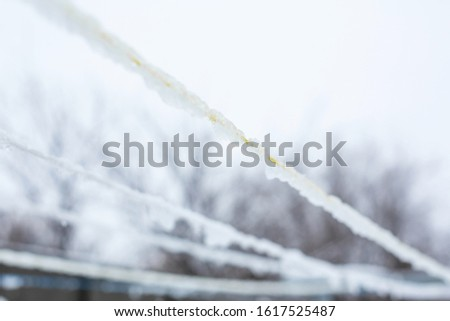 An iced rope for drying clothes. Drying clothes in winter.