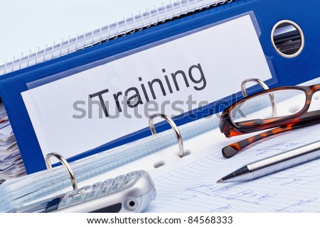 an icon picture for further education, training and adult education. folder and documents in a seminar