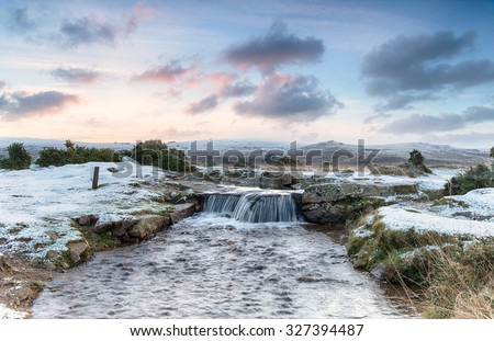 an idyllic winter scene with...