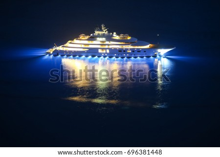 An illuminated luxury yacht in the Adriatiac sea at night in Dalmatia, Croatia. stock photo