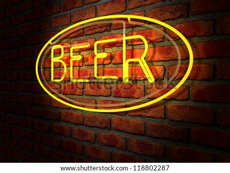 An illuminated orange neon sign with the word beer on it mounted on a brick wall - stock photo
