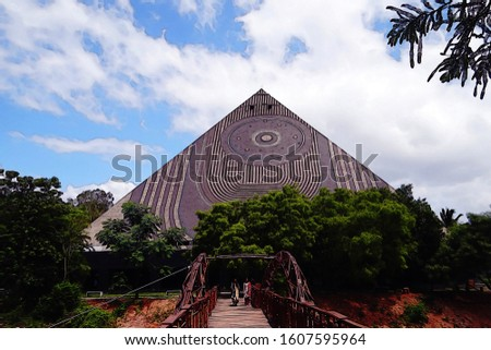 An illustration in a digital painting style of a giant yoga pyramid with spirals on it for decoration. Digital artwork