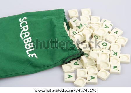 An illustrative editorial concept with Scrabble game and Scrabble distributed by Mattel. Scrabble letter tiles on the isolated background with Scrabble bag in Konak,Izmir,Turkey- June 15, 2014