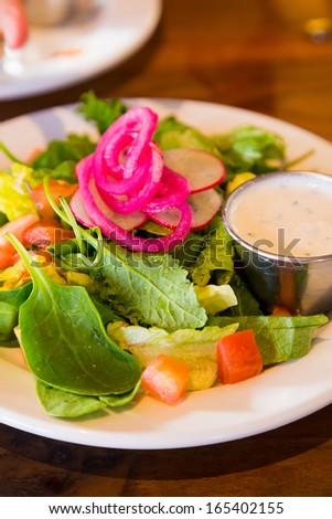 An image from a restaurant while dining out of a healthy salad that is low calorie and ready to eat.