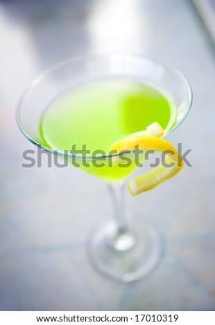 An image of a apple martini with a lemon twist - stock photo