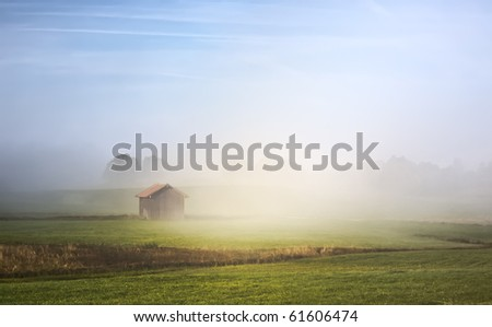 An image of a beautiful landscape with fog in bavaria germany