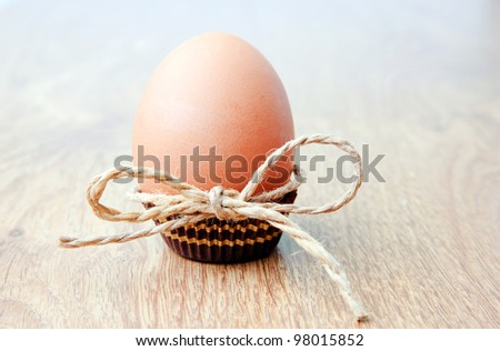 An image of a big easter egg on a table