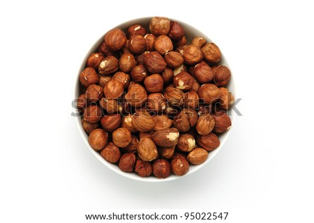 An image of a bowl with brown hazel-nuts - stock photo