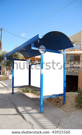 An image of a bus stop with a blank billboard for your advertising situated on the greek island of crete.