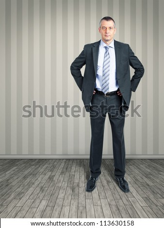 An image of a business man standing in the empty room