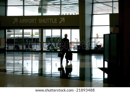 An image of a business man walking out of the airport