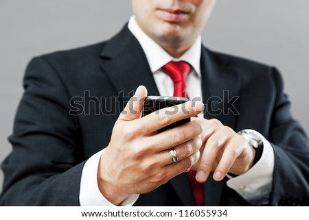 An image of a business man with his mobile phone