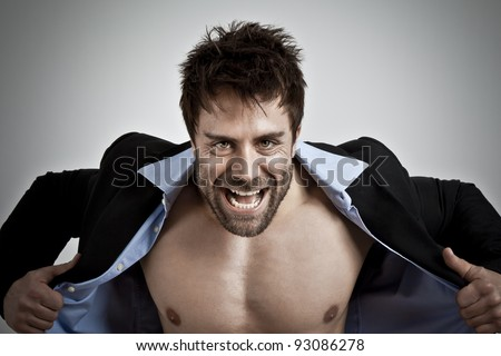 An image of a business man with muscles