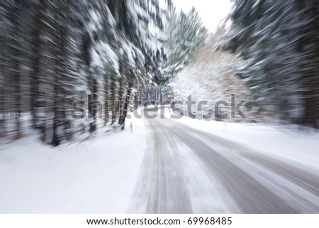 An image of a deep winter snowy road with a zoom