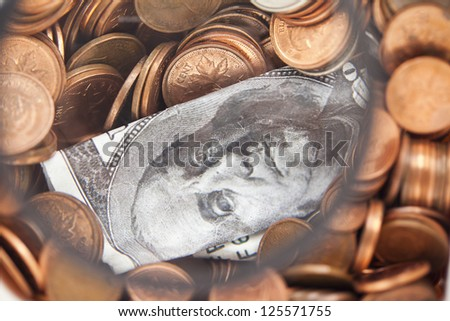 An image of a dollar bill center on the golden coins isolated