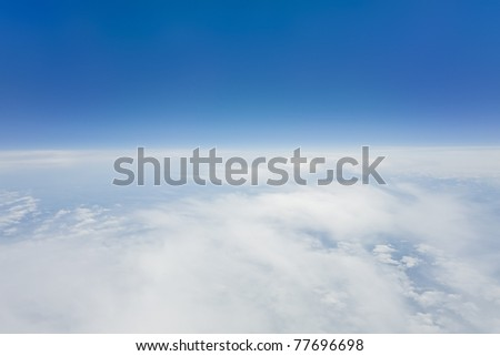 An image of a flight over the clouds