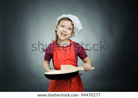 An image of a funny girl in white hat with frying pan