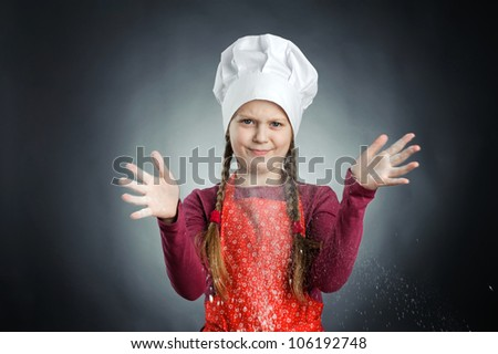 An image of a funny little girl in white hat