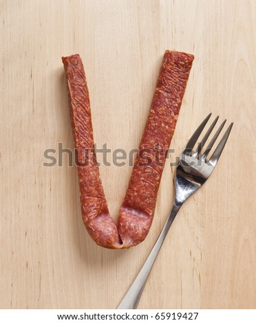An image of a german sausage and a fork