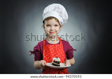 An image of a girl in a white hat with a cake on a plate