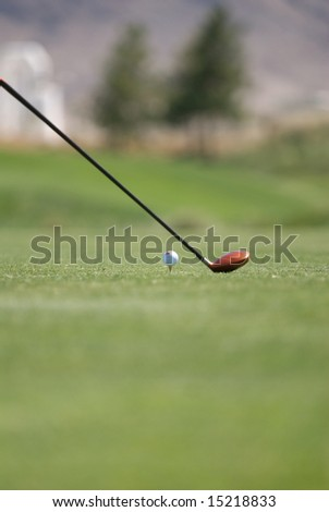 An image of a golf club and ball on tee