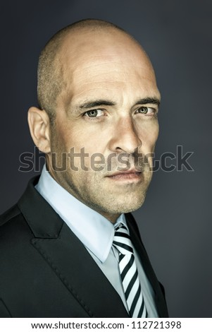 An image of a handsome bald head man