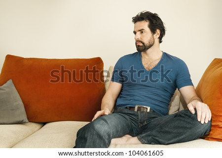 An image of a handsome but depressed man with a beard