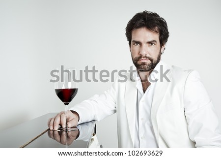 An image of a handsome man and a glass of red wine