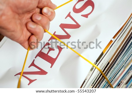 An image of a heap of magazines - stock photo