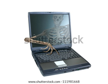 An image of a human skeleton inside a computer trying to reach out of the screen and take over the computer, emblematic of a computer virus or hacker attack.