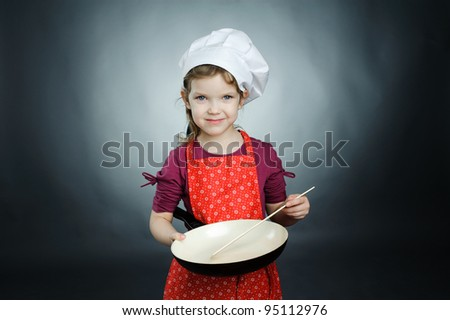 An image of a little girl in white hat with frying pan