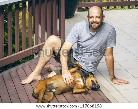An image of a man and his dog