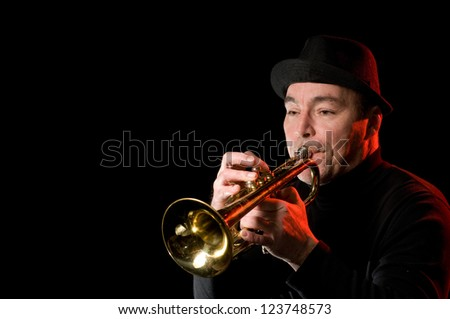 An image of a man playing the trumpet - stock photo