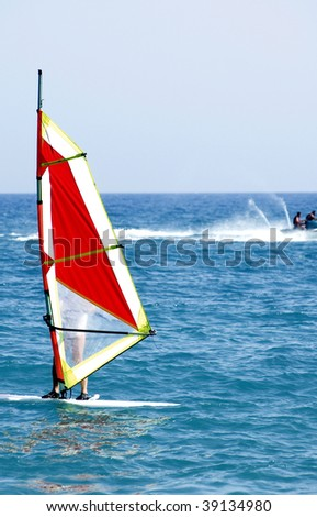 an image of a man windsurfing on summer time - stock photo