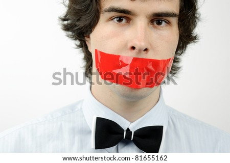 An image of a man with a tape on his mouth