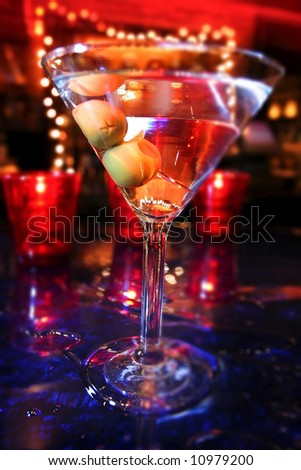 an image of a martini with olives